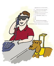 man with guide dog sitting at computer
