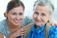 older woman with personal assistant